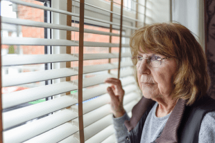 old woman looking through window 310x207 - Are you using Sublimation as a Psychological defence?