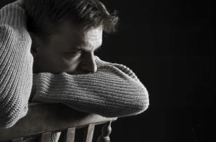 sad man sitting on chair 310x205 - Schizophrenia: Meaning, Causes, Symptoms & Treatment